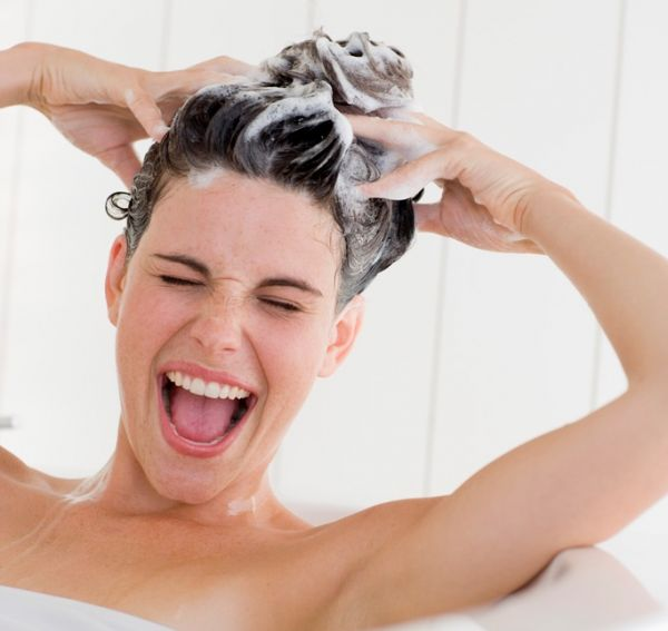 Happy woman washing her hair